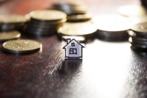 real estate loan concept, money for home, gold coins and house